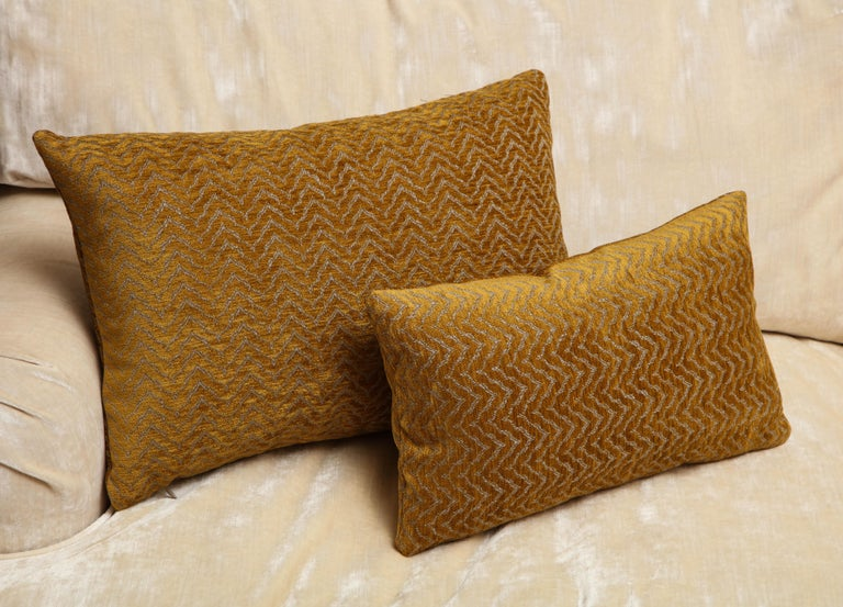 Modern custom-made pillows in wool and silk. One of the kind, a pair of decorative pillows, one smaller and one larger designed by Arlene Angard Design. Hand sewing technique and insert of down feathers Ideal for any stylish space that need a