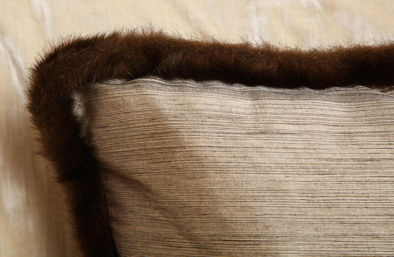 Chic and one of kind silk and fur pillow. Silver and bronze textile with chestnut fur. The textile has Japanese English provenance from England. Early 20th century. And the European fur around exudes Anglo-Japanese style. The pillow is perfect in
