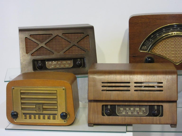 A collection of seven molded plywood radios designed by Ray and Charles Eames consisting of two Zenith, two Emerson, two Teletone and one Hoffman radio. All in very good condition most are in original condition. The radios date from the mid to late