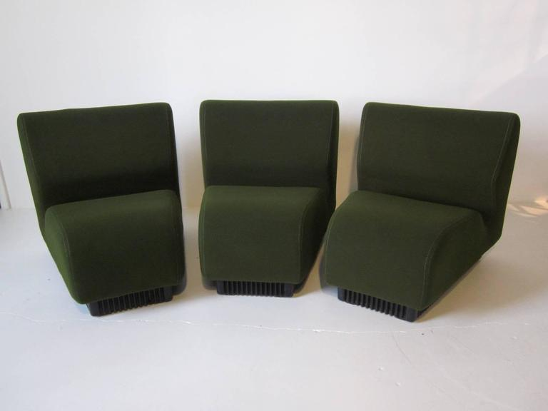 A Three Piece Pie Shaped Modular Sofa Set In Olive Green Using Smooth And  Soft