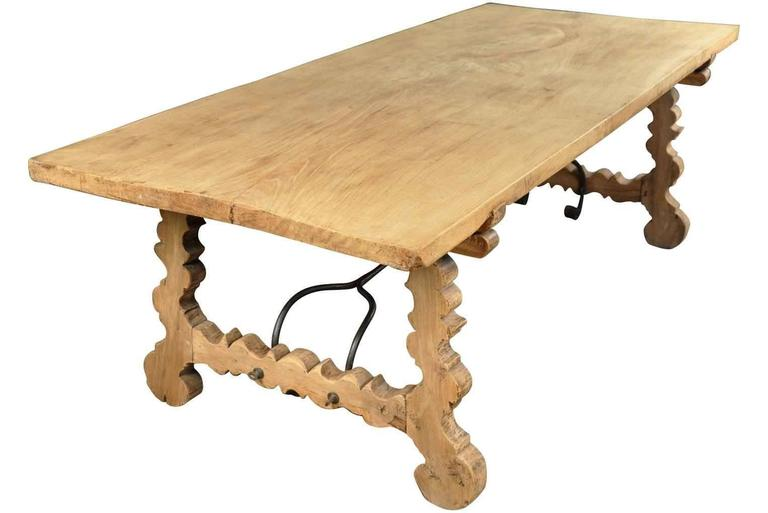 A very striking 19th century Spanish farm table constructed from bleached or washed oak and hand-forged iron stretchers. Wonderful not only as a dining table, but as a large console or writing table as well.