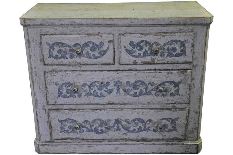 A very charming 19th century commode from Spain. The chest has a terrific painted finish with blue detailing. This commode will serve wonderfully as a bedside cabinet or converted into a bathroom or powder room vanity.