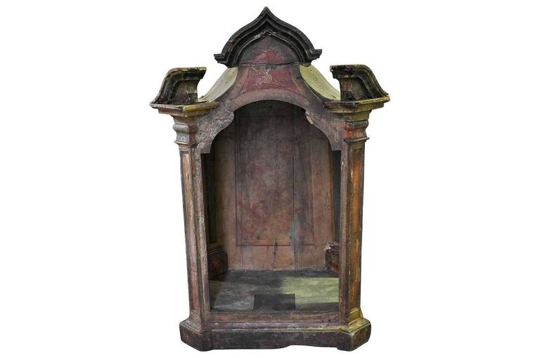 18th century spanish polychromed tabernacle, niche for the display of Santos. Original finish in somber tones of ochre and siena.
