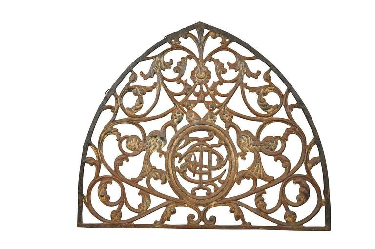 A wonderful French 18th century Gothic style architectural fragment - over door pediment. Expertly crafted in cast iron and retaining traces of the original paint. Wonderful s a wall-mounted piece, converted into a mirror or incorporated into a