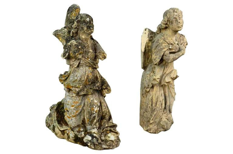 An exceptional and exquisite pair of 18th century French hand-carved stone angels. Breathtaking! A magnificent addition to any interior or garden!