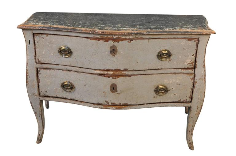 A very lovely French mid-19th century painted commode. Beautifully constructed with a graceful serpentine movement, two drawers on soft cabriole legs. A wonderful piece for any foyer, living area or bedroom. It would also convert beautifully into a
