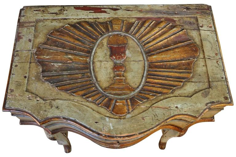 A very rare and outstanding 17th century traveling prayer table from the Veneto area of Italy. Such a table was taken along on voyages so that the owner could pray and meditate. Wonderful painted finish and wonderful carvings. The top lifts to