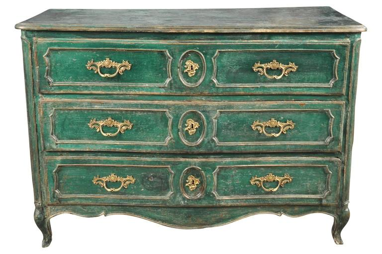 A very handsome Louis XV Arbalette commode in painted wood. Striking color and painted finish. Wonderfully constructed from solid oak with molded drawer fascias and side panels.