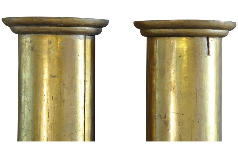 A very lovely pair of early 19th century French half rounded columns in giltwood. Wonderful architectural fragments to build into a mantel, window or doorway.