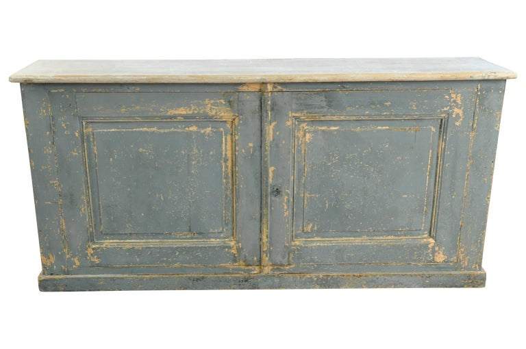 A charming later 19th century buffet from the South of France. Soundly constructed from painted wood. Terrific narrow depth. Wonderful painted finish and patina.