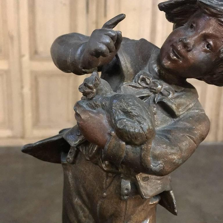 Pair of 19th century Romantic Spelter statues by Auguste Moreau, considered one of the three pre-eminent sculptors of the Belle Époque in late 19th century, France. Depicting a young lad and maiden attempting to protect a young bird from the