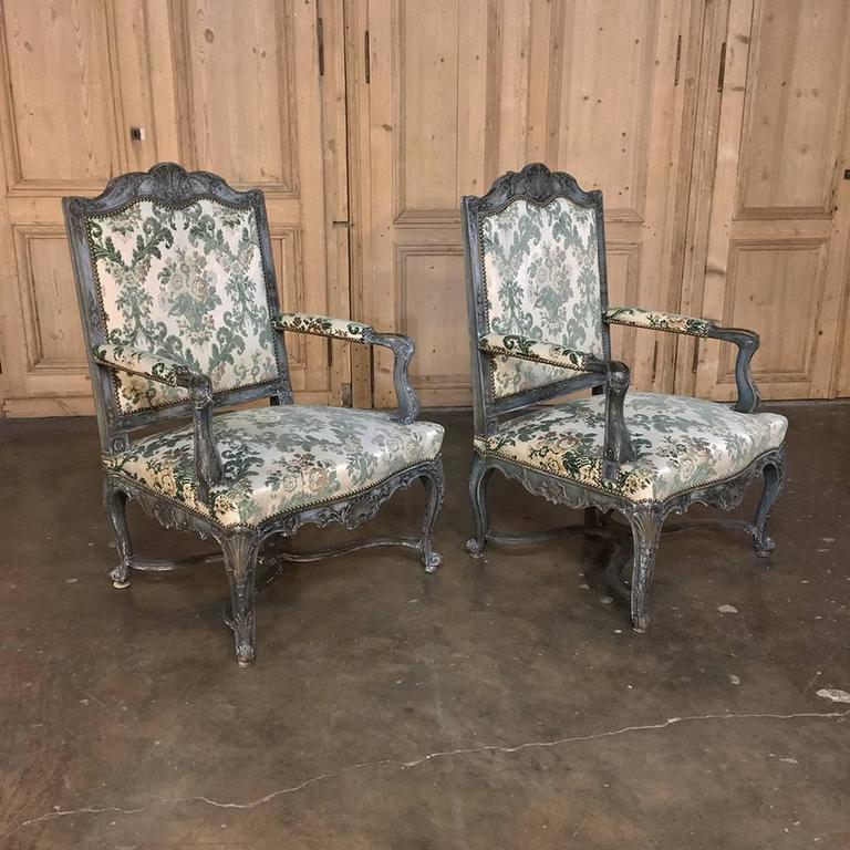 Pair of 19th Century French Louis XIV Painted Armchairs are a feast for the eyes! Gracefully contoured and sculpted frames were hand-carved from solid walnut then given a patinaed painted finish which accentuates the fine hand-carved detailing that