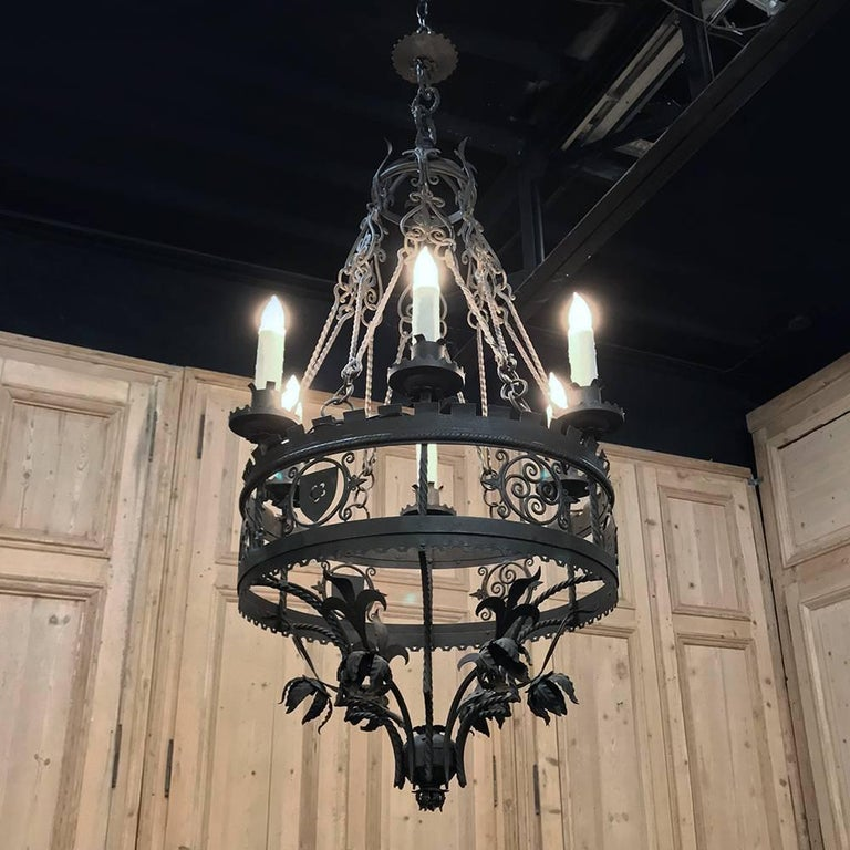 Antique Italian wrought iron chandelier will definitely command attention the minute one walks into the room! Hand-forged to an amazing degree of detail, it will add an unforgettable ambiance to any home or office.