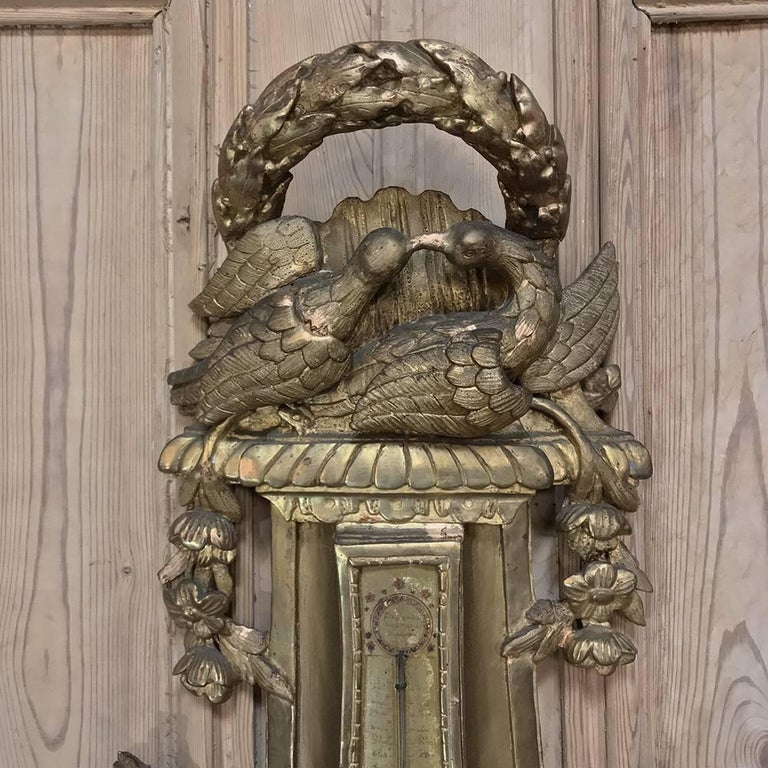 18th century giltwood hand-carved barometer - thermometer is a remarkable instrument of technology that is surprisingly accurate, especially for being over 200 years old! Hand-carved casework features sculptures of lovebirds on top surrounded by a