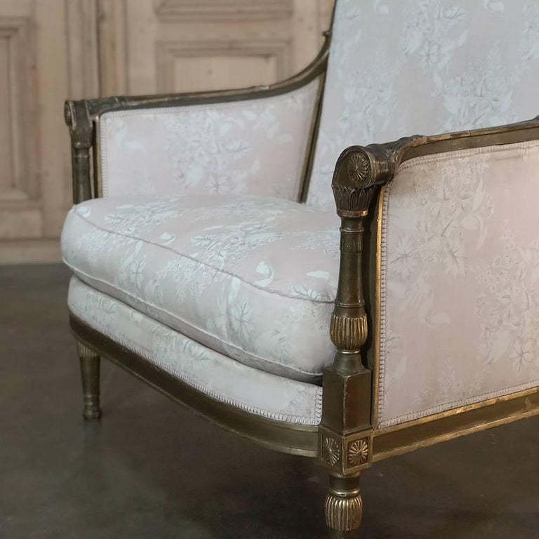 Many are under the mistaken impression that this concept is recent, but here stands before you a 19th century French Louis XVI armchair and a half with original gilded finish that has achieved a lovely distressed patina over the past century!
