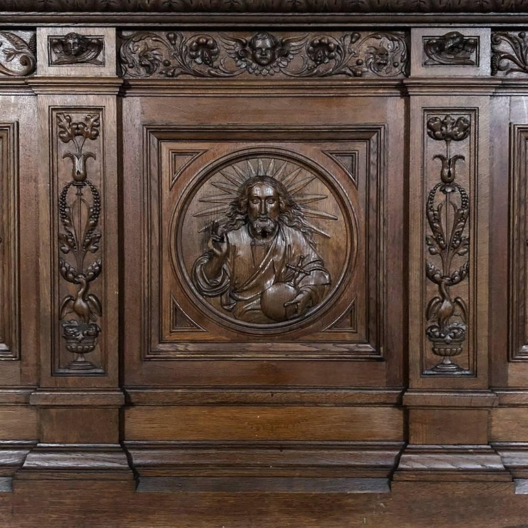 19th century carved chapel altar was found in a charming villa along the French border and features a remarkable display of full relief sculptures of the Holy Family, with cherubs and foliates and other religious symbols in abundance on the