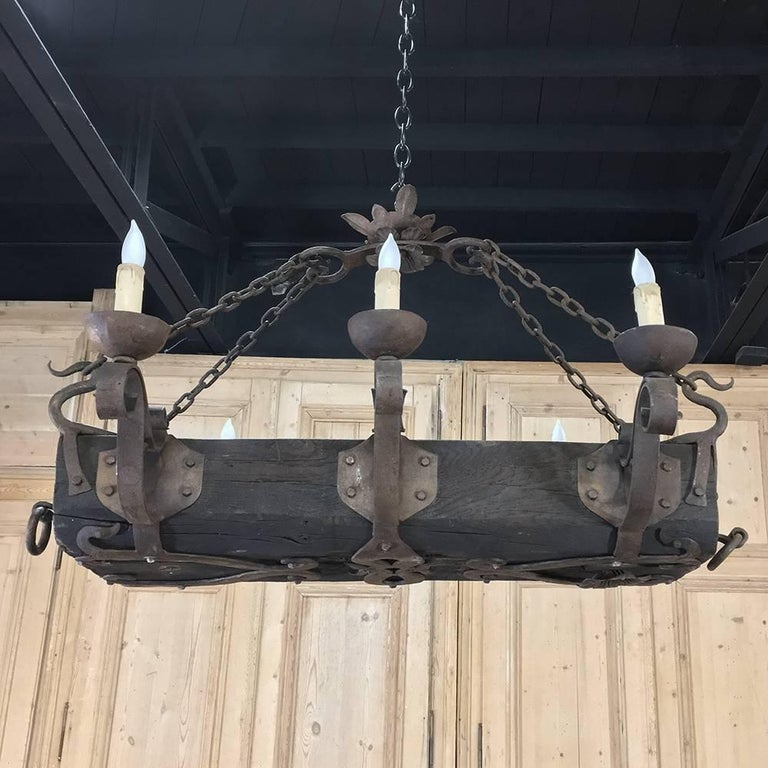 Antique country french wood and wrought iron chandelier at 1stdibs rustic antique country french wood and wrought iron chandelier for sale aloadofball Gallery