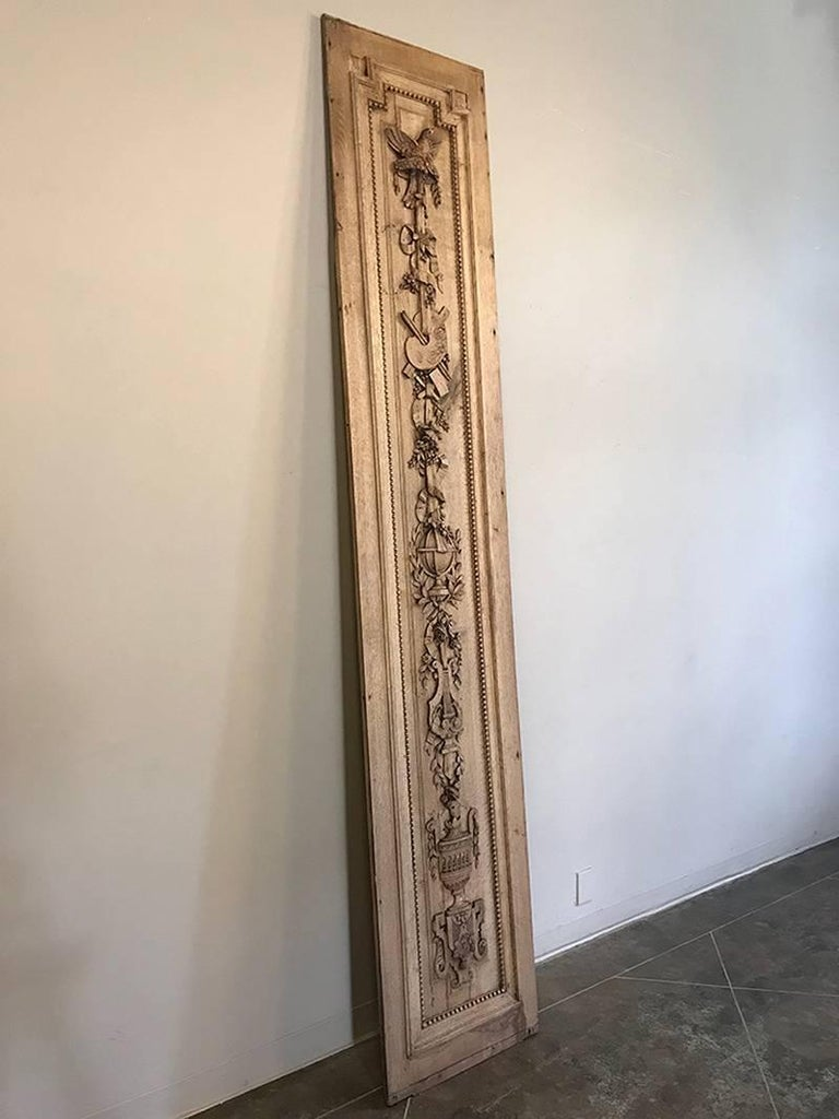 This grand 19th century French Louis XVI hand-carved oak panel is over nine feet tall! Makes is a great choice for dramatic adding a touch of style to any narrow space! Hand-sculpted from one solid plank of oak, it features classical motifs