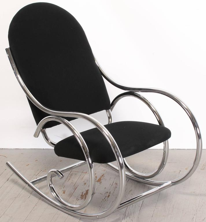 Italian chrome rocking chair, probably upholstered and sold by Selig Manufacturing Co, retains original upholstery tag with license number that has been found on marked Selig pieces. There are similar chairs, it is obvious that this is a higher