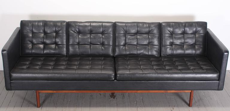 Original black vinyl upholstered Mid-Century Modern sofa designed Milo Baughman for Thayer Coggin in the Danish style. The walnut frame base retains original finish. A great example of American Modern.  Condition: The right seat cushion has several