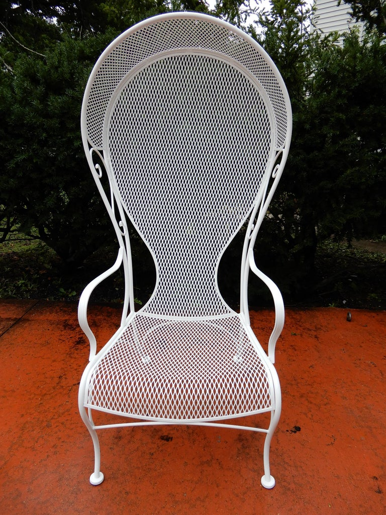 A Vintage Woodard Hooded Wrought Iron Chair The Has Just Been Painted White And