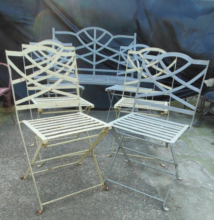 good Folding Wrought Iron Chairs Part - 7: This is an unusual seven piece patio set with six bistro or folding chairs,  en