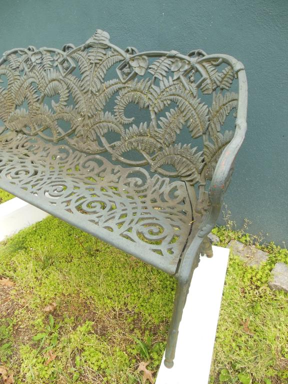 An Antique Cast Iron Garden Bench In The Desirable Fern Pattern. The Detail  Of The