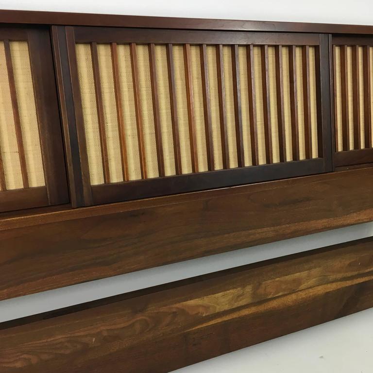 A rare Nakashima headboard. Original pandanus cloth doors. Provenance accompanies.