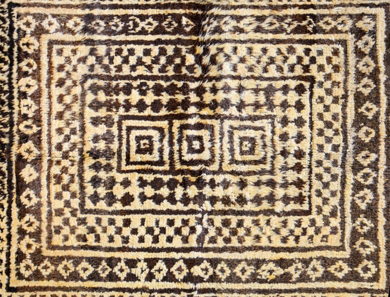 A fantastic 19th century, Persian Gabbeh rug with an amazing composition of geometric patterns including diamonds, squares, zigzags, checkerboards and stripes, all woven in natural undyed wool.