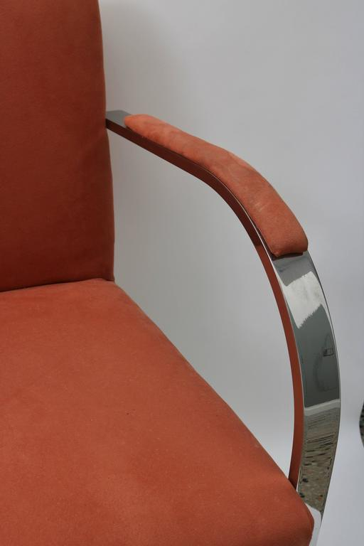 This set of six Brno chairs with their solid, polished steel frames date from the 1970s-1980s and are upholstered in a salmon colored ultra-suede fabric. The metal is in very good condition and the fabric does show wear.  Note: Arm height is 26.25