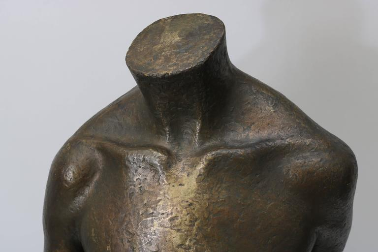 This Mid-Century Modern bronze sculpture of a female torso was created by the American sculptor Lewis Iselin and was recently acquired from a Palm Beach estate. 