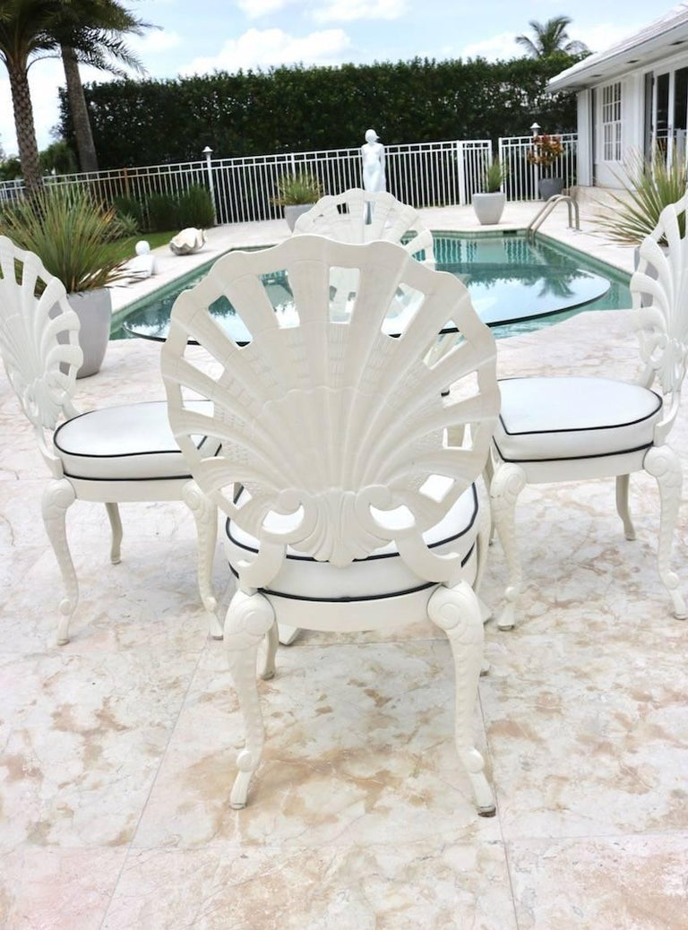 brown jordan grotto shell back chairs and round glass top table in