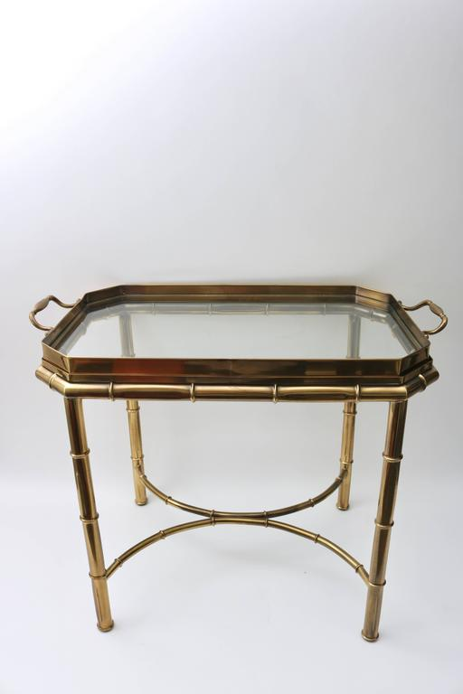 This stylish Master Craft furniture, Hollywood Regency faux bamboo table has a removable tray top that make serving an ease. The antique brass finish is subtle and Classic and has been maintained beautifully.