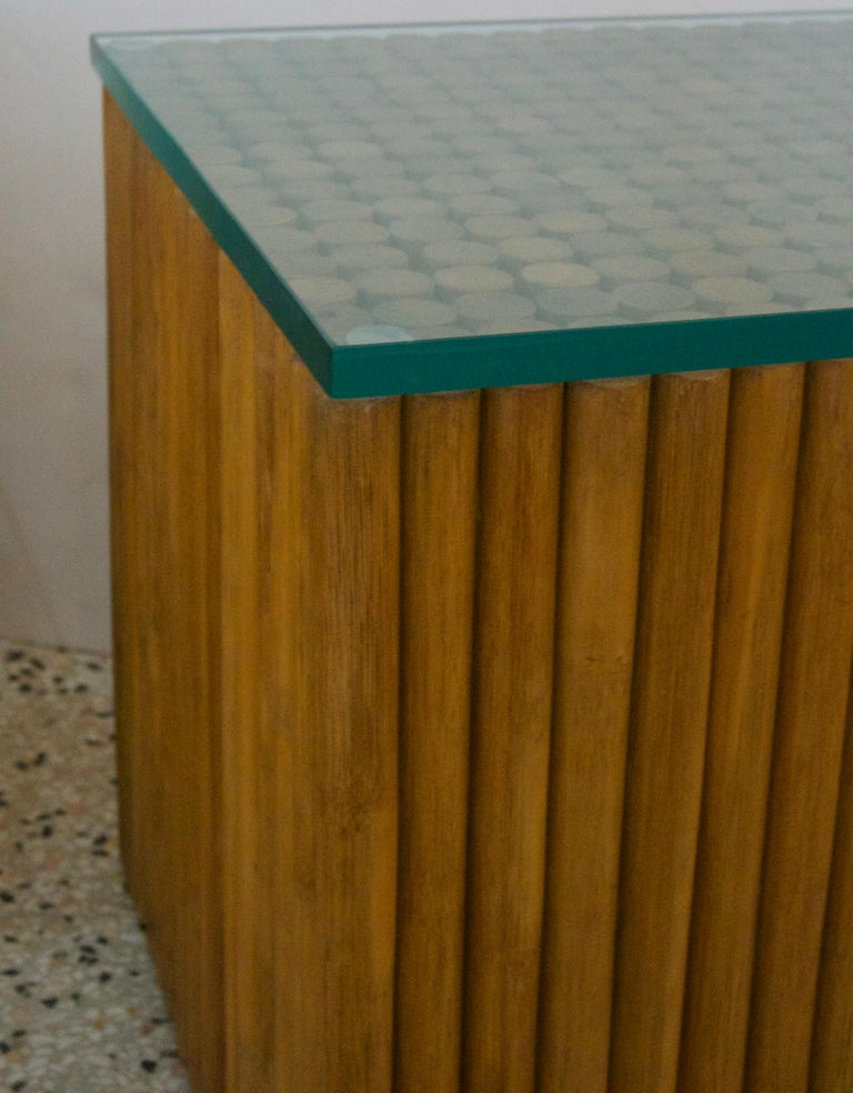 This stylish pair of bamboo side tables will add that bohemian and moderne look to your home.  The can be used as cocktail tables or as side tables.