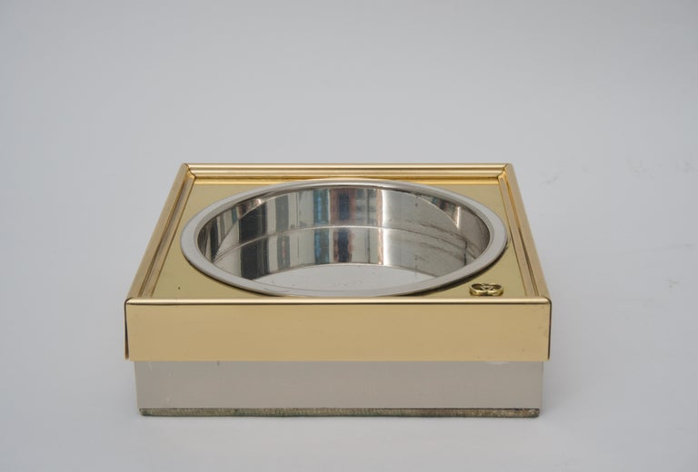 This stylish two-piece set of Gucci ash tray and lighter date to the 1970s and have been professionally polished and lacquered.