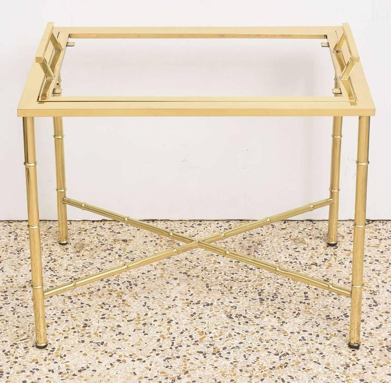 This stylish polished brass faux bamboo and glass cocktail table dates to the 1960s-1970s and was created by Mastercraft. The piece has been professionally polished and clear coated. 