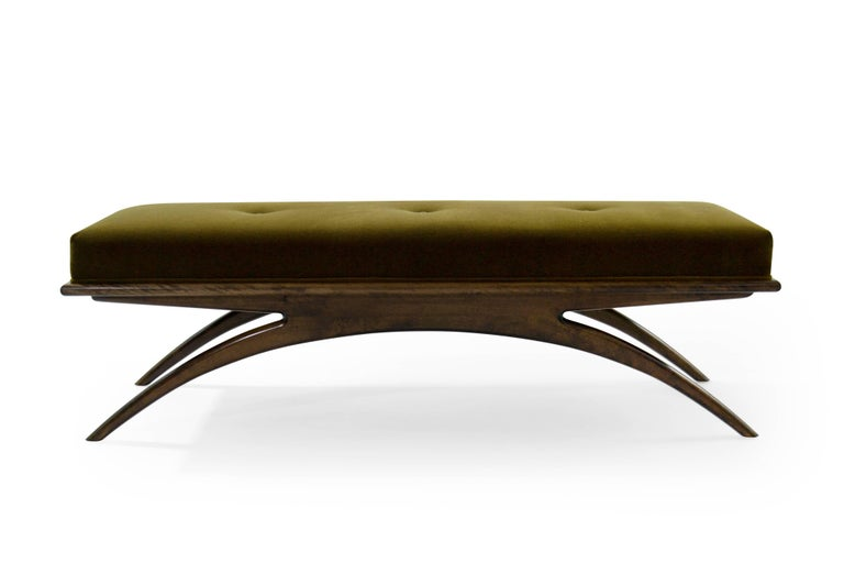 Artfully balanced. This handcrafted bench has a lightweight aesthetic with solid construction. The prim, rectangular cushion is beautifully upholstered in an spectacular chartreuse mohair by Holly Hunt, resting delicately on a solid walnut base.