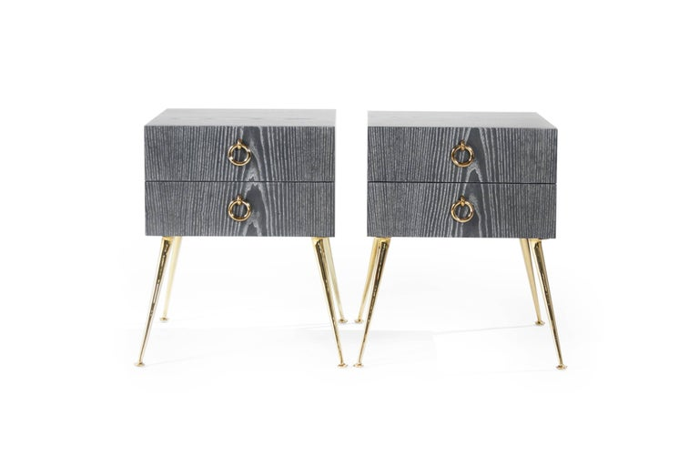 These mid-century modern tables are inspired by T.H. Robsjohn-Gibbings, whose design style captured fluid, water-like movement in furniture. Every leg is hand-cast in brass, tapering at an angle to finish in a subtle, melted pool. Large, matching