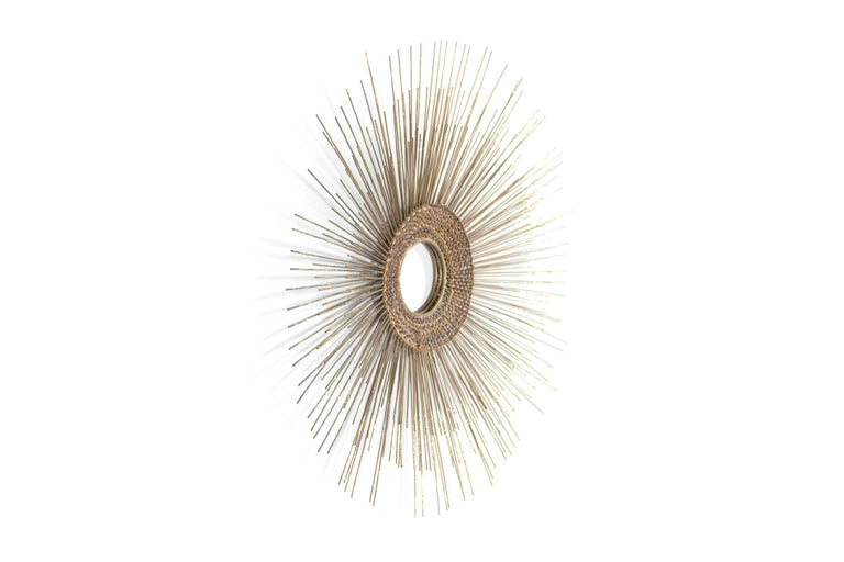 Rare 1950s copper and brass sunburst wall sculpture in the style of Curtis Jere.