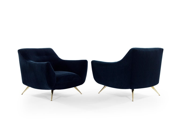 Pair of Henry Glass lounge chairs, newly upholstered in midnight blue mohair.  Chairs have been completely restored to their original integrity. They boast handcut high grade foam, as well as hand polished brass legs. Extremely rare pair perfect