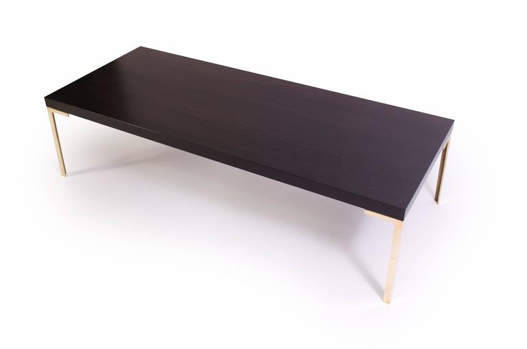 A stunning creation by Montage, the Astor cocktail table. This piece was designed with the Mid-Century in mind embodying delicate proportions and bold use of the highest quality materials. 