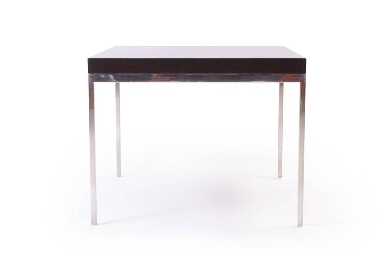 A powerful modernist design using the best materials. A solid plinth of walnut wood with a deep ebony stain mounted atop a sleek solid stainless steel frame. The piece is proportionally delicate and structurally heavy, incredible quality. Perfect