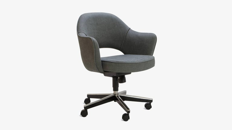 Mid-Century Classic Eero Saarinen Executive Arm Chair, manufactured by Knoll Furniture. These are custom upholstered in a textured Charcoal Weave. We completely restore each chair in our in-house workroom and in addition to new fabric we replace the