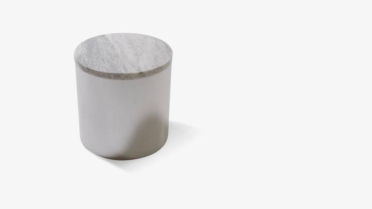 A delicately proportioned clean-lined accent table designed by Paul Mayen for Habitat. Mayen's sense of materiality was spectacular, evident in this Minimalist piece. A simple round cut piece of carrara marble fits seamlessly into a polished steel