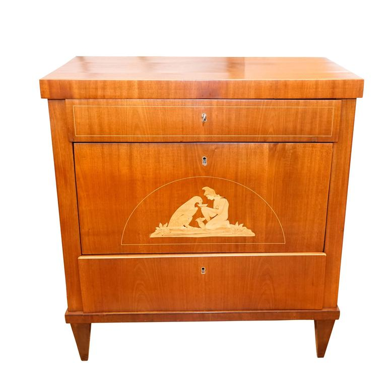 A petite chest of drawers, crafted of solid mahogany and fir, the piece is veneered with light mahogany with birch banding and marquetry. Bone escutcheons line the keyholes. The locks and keys are functioning and original.