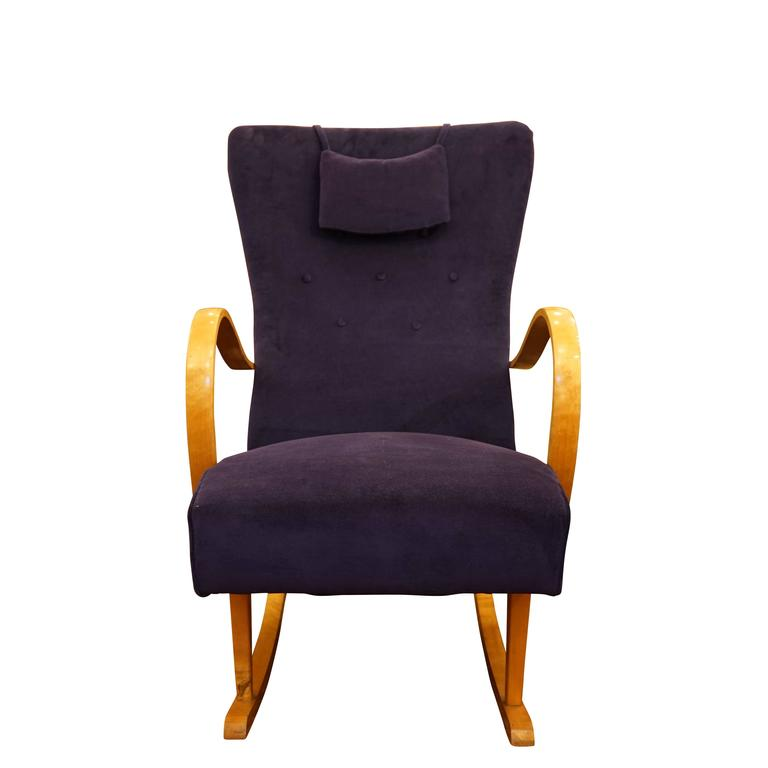 Crafted of solid birch and recently reupholstered in a lush purple velvet, the sprung seat, contoured back and attached head pillow offer exceptional comfort.