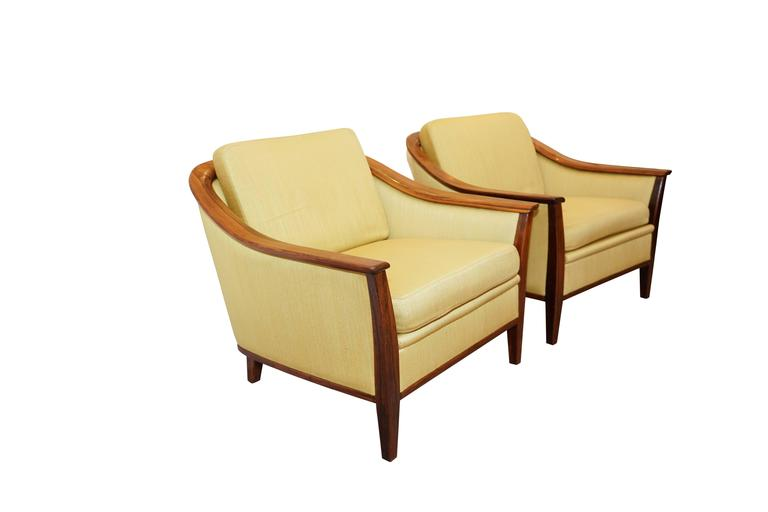 Sleekly Swedish, this ensemble is as comfortable as it is beautiful. Framed in solid jacaranda and bearing the original honey toned upholstery, the set is also offered as a pair of chairs or the sofa independently. Please contact us for separate