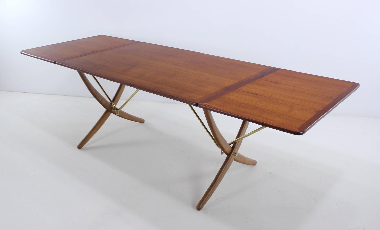 Danish Modern Six Chair Drop Leaf Dining Set Designed By Hans Wegner For Sale