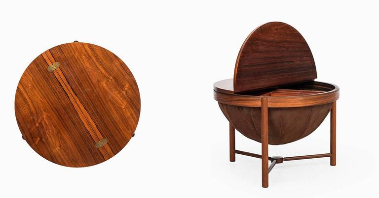 Side table by Rolf Rastad & Adolf Relling. Produced by Rasmus Solberg in Norway, 1962. Rosewood, brass details and brown fabric. Good vintage condition, with small signs of usage. Dimensions (W x D x H): 59.5 x 59.5 x 42 cm.