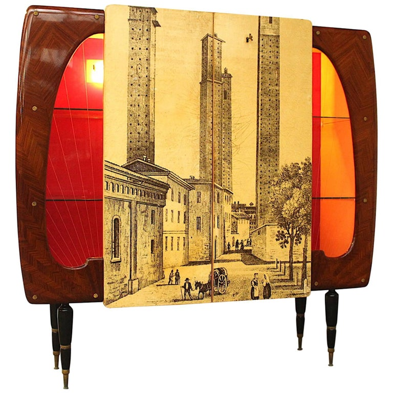 Amazing and very unusual cabinet or cupboard in the style of Piero Fornasetti. Beautiful inlay fish bone patterned rosewood and in the middle two doors with original key featuring the famous medieval Twin Towers of the town of San Gimignano in